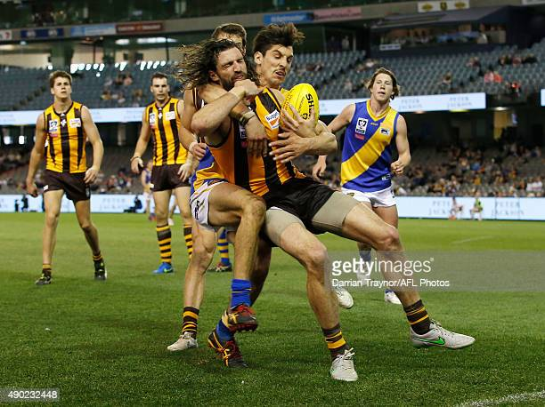 Leigh Masters of Williamstown tackles Matt Spangher of Box Hill high during the VFL Grand Final match between Williamstown and Box Hill at Etihad...