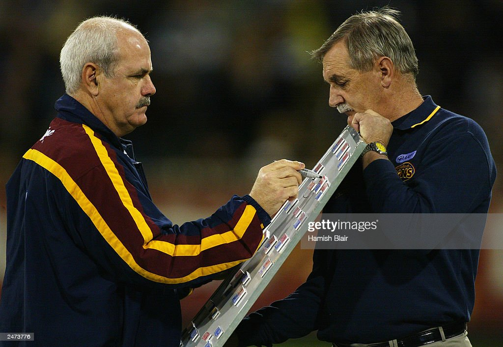Leigh Matthews coach of Brisbane makes his changes at quarter time during the AFL Second Qualifying Final between the Collingwood Magpies and the Brisbane Lions at the Melbourne Cricket Ground on September 6, 2003 in Melbourne, Australia.