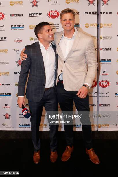 Leigh Montagna and Nick Riewoldt arrive ahead of the AFL Players' MVP Awards at Shed 14 Central Pier on September 12 2017 in Melbourne Australia