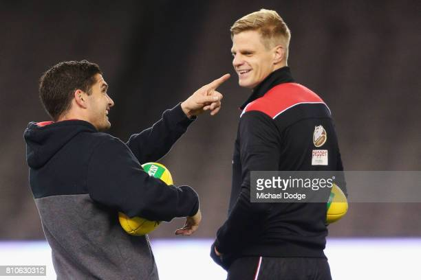 Leigh Montagna and Nick Riewoldt of the Saints react at seeing their headshots on screen during the round 16 AFL match between the St Kilda Saints...
