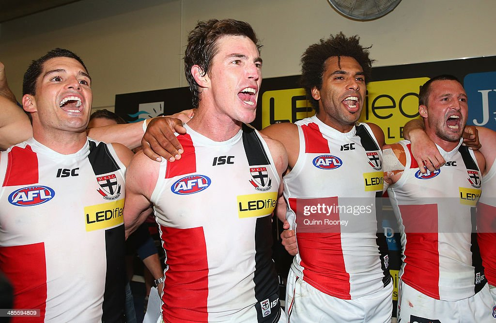 Leigh Montagna, Lenny Hayes, James Gwilt and Jarryn Geary of the Saints sing the song in the rooms after winning the round five AFL match between the Essendon Bombers and the St Kilda Saints at Etihad Stadium on April 19, 2014 in Melbourne, Australia.
