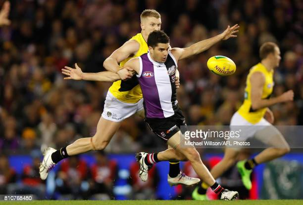 Leigh Montagna of the Saints and Josh Caddy of the Tigers compete for the ball during the 2017 AFL round 16 match between the St Kilda Saints and the...