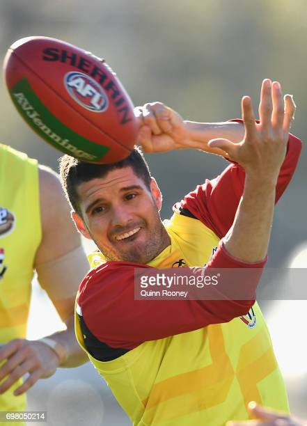 Leigh Montagna of the Saints handballs during a St Kilda Saints AFL training session at Trevor Barker Beach Oval on June 20 2017 in Melbourne...