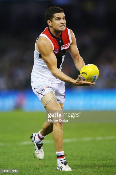Leigh Montagna of the Saints handballs during the round four AFL match between the Collingwood Magpies and the St Kilda Saints at Etihad Stadium on...