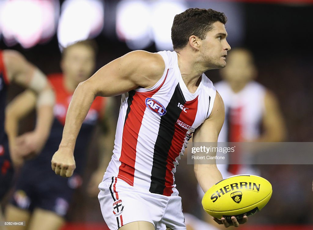 Leigh Montagna of the Saints handballs during the round six AFL match between the Melbourne Demons and the St Kilda Saints at Etihad Stadium on April 30, 2016 in Melbourne, Australia.