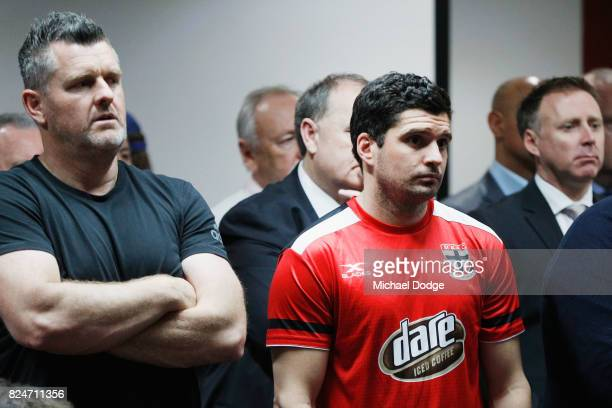 Leigh Montagna of the Saints listens on as teammate Nick Riewoldt announces his retirement during a St Kilda Saints AFL press conference at Linen...