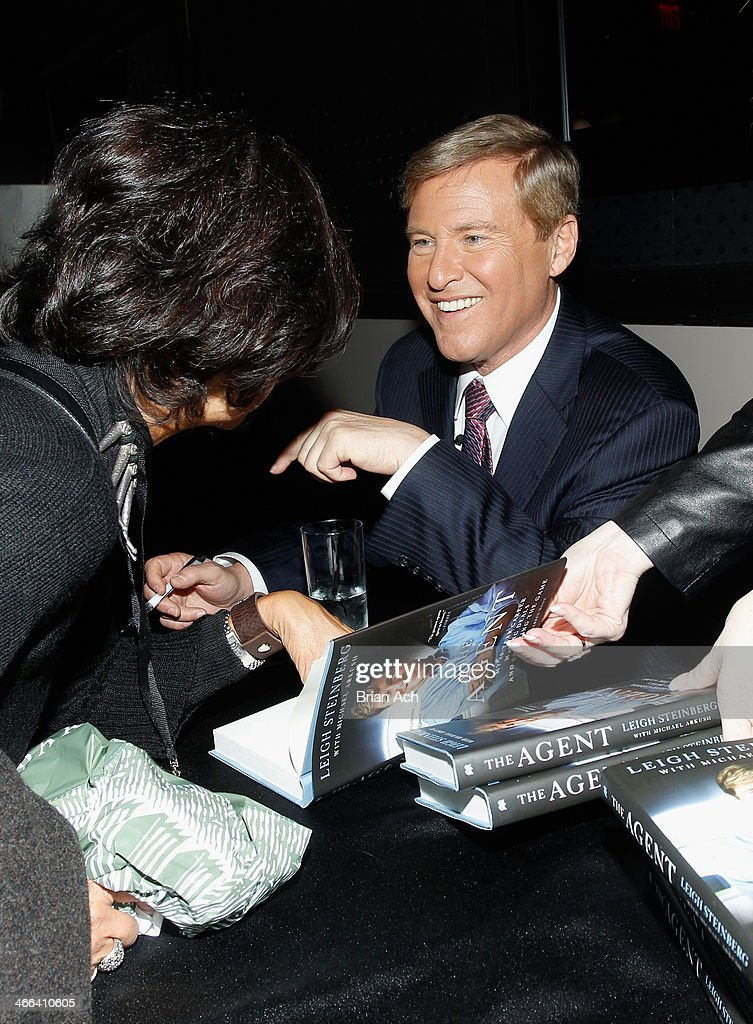 <a gi-track='captionPersonalityLinkClicked' href=/galleries/search?phrase=Leigh+Steinberg&family=editorial&specificpeople=221448 ng-click='$event.stopPropagation()'>Leigh Steinberg</a> signs copies of his book at the 2014 <a gi-track='captionPersonalityLinkClicked' href=/galleries/search?phrase=Leigh+Steinberg&family=editorial&specificpeople=221448 ng-click='$event.stopPropagation()'>Leigh Steinberg</a> Super Bowl Party at 230 Fifth Avenue on February 1, 2014 in New York City.