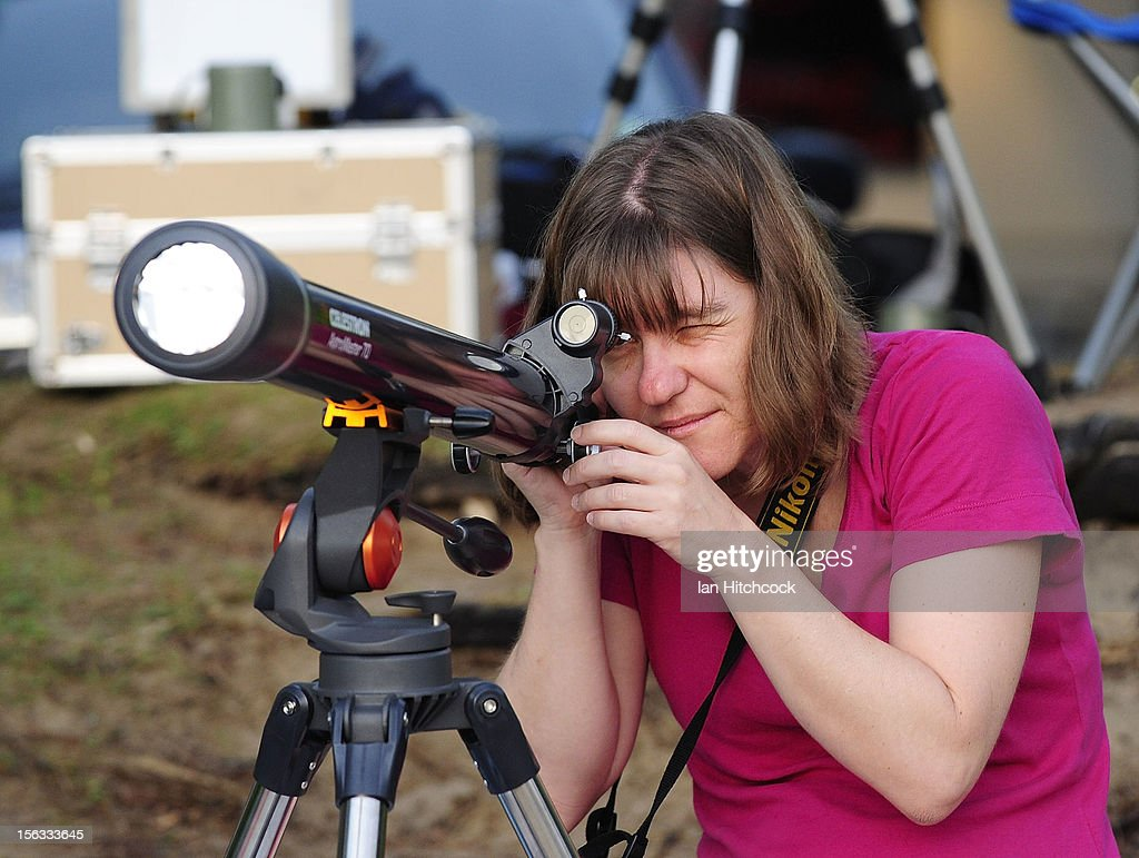 Leigh Turner uses a telescope to watch the total solar eclipse on November 14, 2012 in Palm Cove, Australia. Thousands of eclipse-watchers have gathered in part of North Queensland to enjoy the solar eclipse, the first in Australia in a decade.