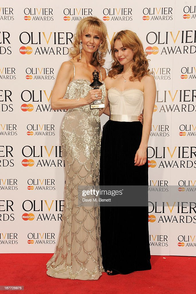 Leigh Zimmerman (L), winner of Best Performance in a Supporting Role in a Musical, and Lily James pose in the press room at The Laurence Olivier Awards 2013 at The Royal Opera House on April 28, 2013 in London, England.