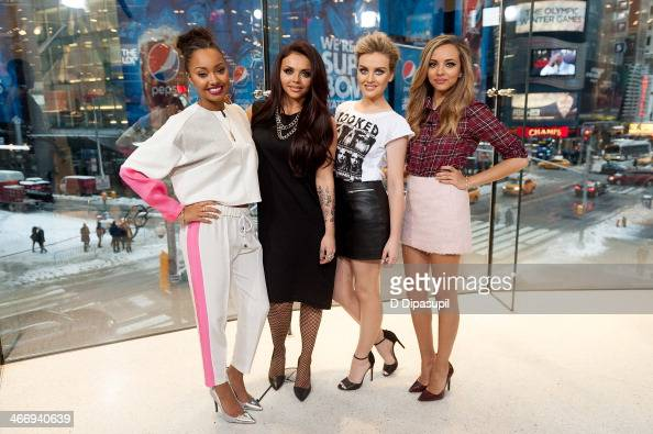 LeighAnne Pinnock Jesy Nelson Perrie Edwards and Jade Thirlwall of Little Mix visit 'Extra' at their HM Studio in Times Square on February 5 2014 in...