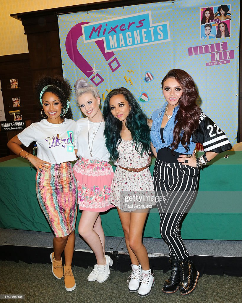 LeighAnne Pinnock Perrie Edwards Jade Thirlwall and Jesy Nelson of the UK Girl Group Little Mix signs copies of their new album 'DNA' on June 9 2013...