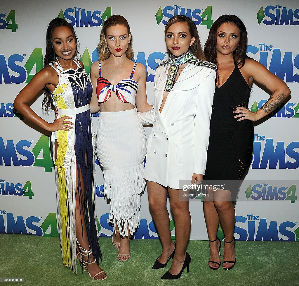 LeighAnne Pinnock Perrie Edwards Jade Thirlwall and Jesy Nelson of Little Mix pose in the green room at the 2015 Teen Choice Awards at Galen Center...