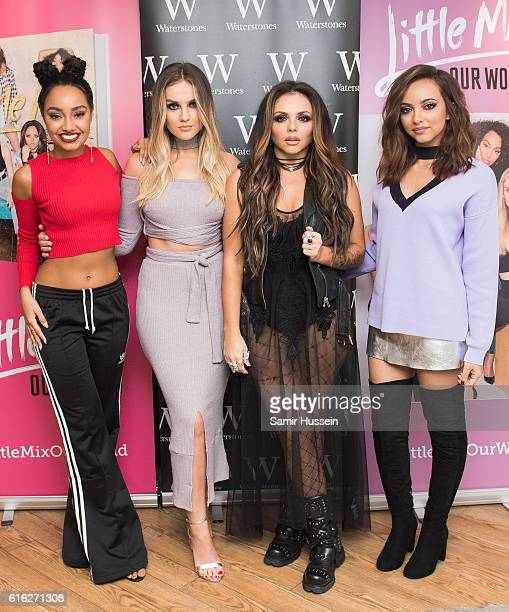 LeighAnne Pinnock Perrie Edwards Jesy Nelson and Jade Thirlwall of pose as they Little Mix sign copies of their new book 'Our World' at Waterstones...