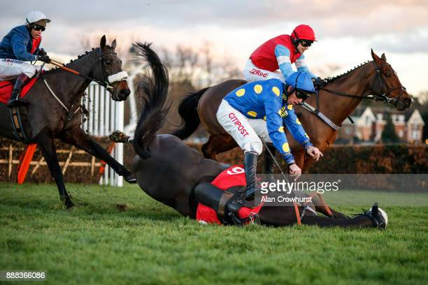 Leighton Aspell fall from Its A Sting at the last at Sandown Park racecourse on December 8 2017 in Esher United Kingdom