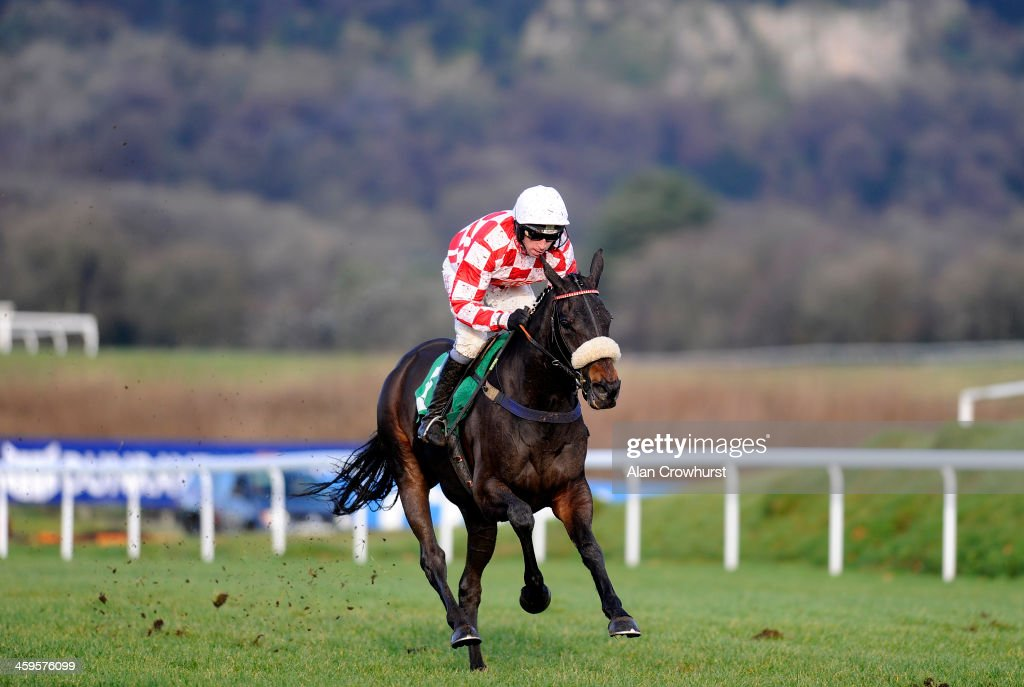 Leighton Aspell riding Deputy Dan clears the last to win The Download The Coral Mobile App Maiden Hurdle Race at Chepstow racecourse on December 28, 2013 in Chepstow, Wales.