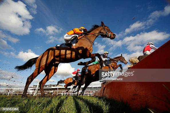 Leighton Aspell riding Fight Commander clear the open ditch on their way to winning The 32Red On The App Store Steeple Chase at Huntingdon racecourse...