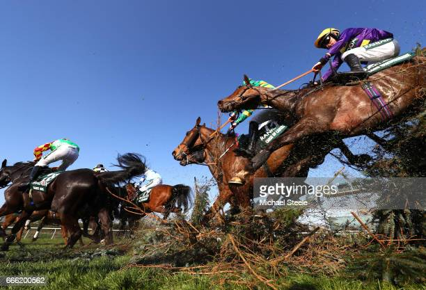Leighton Aspell riding Lord Windermere goes over the Canal Turn during the 2017 Randox Heath Grand National at Aintree Racecourse on April 8 2017 in...