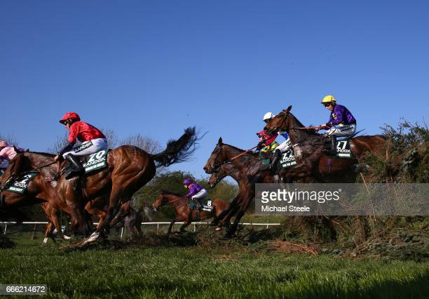Leighton Aspell riding Lord Windermere jumps with Derek Fox riding One For Arthur during the 2017 Randox Heath Grand National at Aintree Racecourse...
