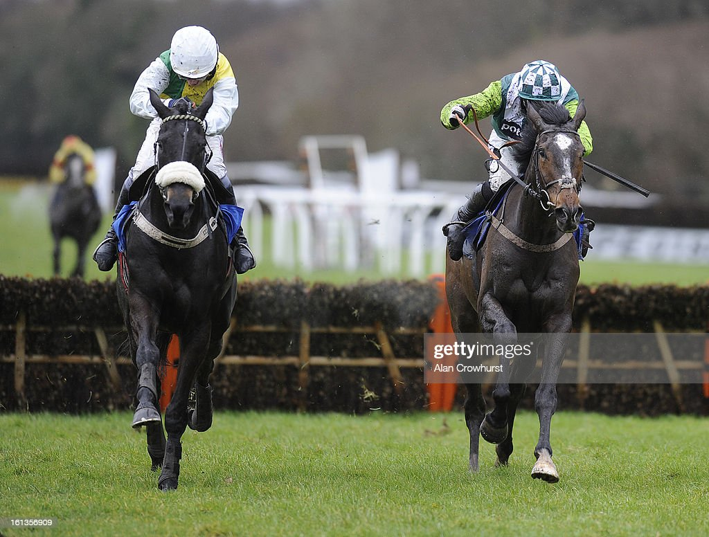 Leighton Aspell riding Many Clouds (L) clear the last to win The Bathwick Tyres 'National Hunt' Novices' Hurdle Race from Just A Par (R) at Exeter racecourse on February 10, 2013 in Exeter, England.