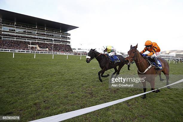 Leighton Aspell riding Many Clouds clear the last to win The BetBright Trial Cotswold Steeple Chase from Thistlecrack at Cheltenham Racecourse on...