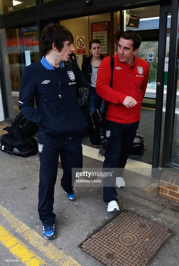<a gi-track='captionPersonalityLinkClicked' href=/galleries/search?phrase=Leighton+Baines&family=editorial&specificpeople=682452 ng-click='$event.stopPropagation()'>Leighton Baines</a> and <a gi-track='captionPersonalityLinkClicked' href=/galleries/search?phrase=Gary+Neville&family=editorial&specificpeople=171409 ng-click='$event.stopPropagation()'>Gary Neville</a> of England travels to London by Train from Birmingham International Train Station on February 5, 2013 in Birmingham, England.