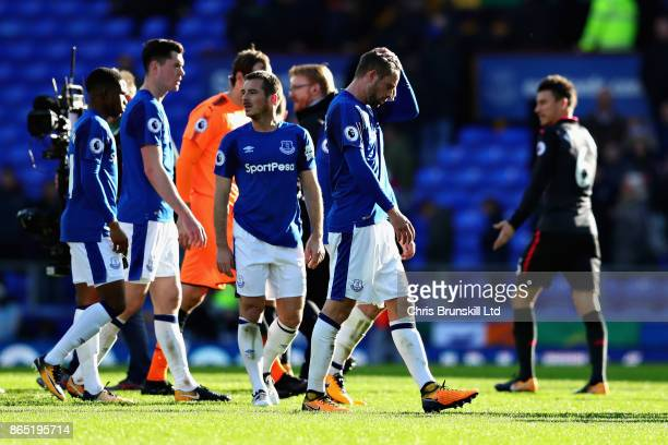 Leighton Baines and Phil Jagielka both of Everton look dejected after the Premier League match between Everton and Arsenal at Goodison Park on...