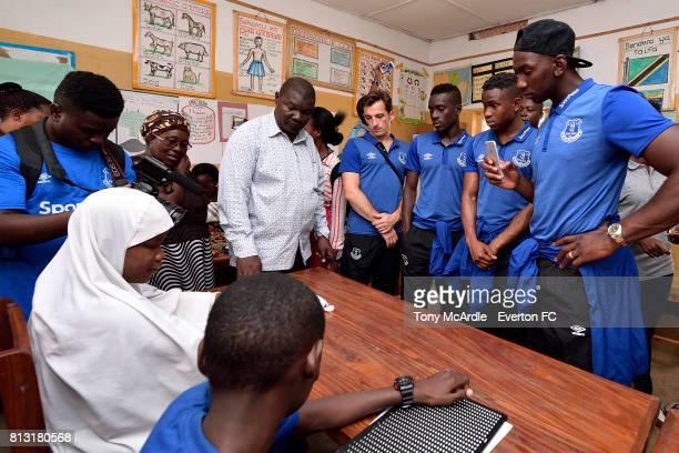 Leighton Baines Idrissa GueyeAdemola Lookman and Yannick Bolasie of Everton visit Uhuru Primary School in DarEsSalaam on July 12 2017 in Halewood...