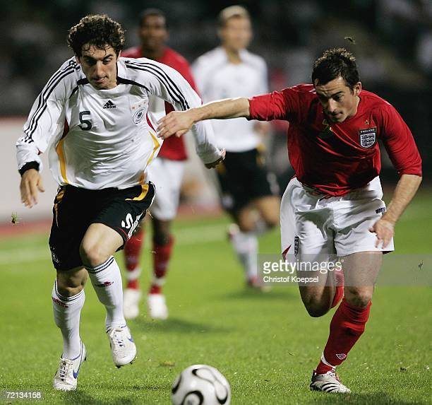 Leighton Baines of England challenges for the ball against Roberto Hilbert of Germany during the Men's European U21 Championship qualifying second...