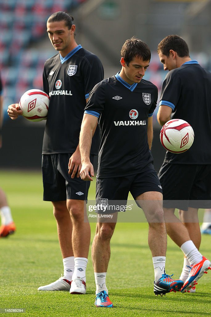 <a gi-track='captionPersonalityLinkClicked' href=/galleries/search?phrase=Leighton+Baines&family=editorial&specificpeople=682452 ng-click='$event.stopPropagation()'>Leighton Baines</a> of England controls the ball as <a gi-track='captionPersonalityLinkClicked' href=/galleries/search?phrase=Andy+Carroll+-+Soccer+Player&family=editorial&specificpeople=1449090 ng-click='$event.stopPropagation()'>Andy Carroll</a> looks on during the England training session and press conference at the Ullevaal Stadion on May 25, 2012 in Oslo, Norway.