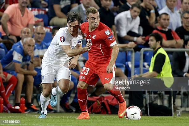 Leighton Baines of England Xherdan Shaqiri of Switzerland during the EURO 2016 qualifying match between Switzerland and England on September 8 2014...