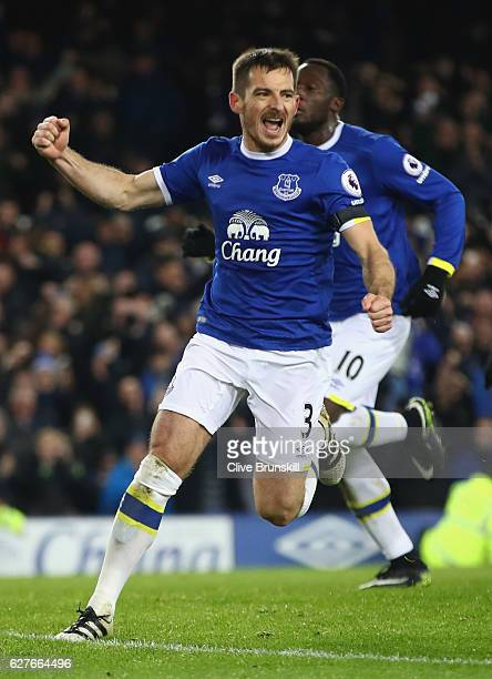 Leighton Baines of Everton celebrates as he scores their first and equalising goal from the penalty spot during the Premier League match between...