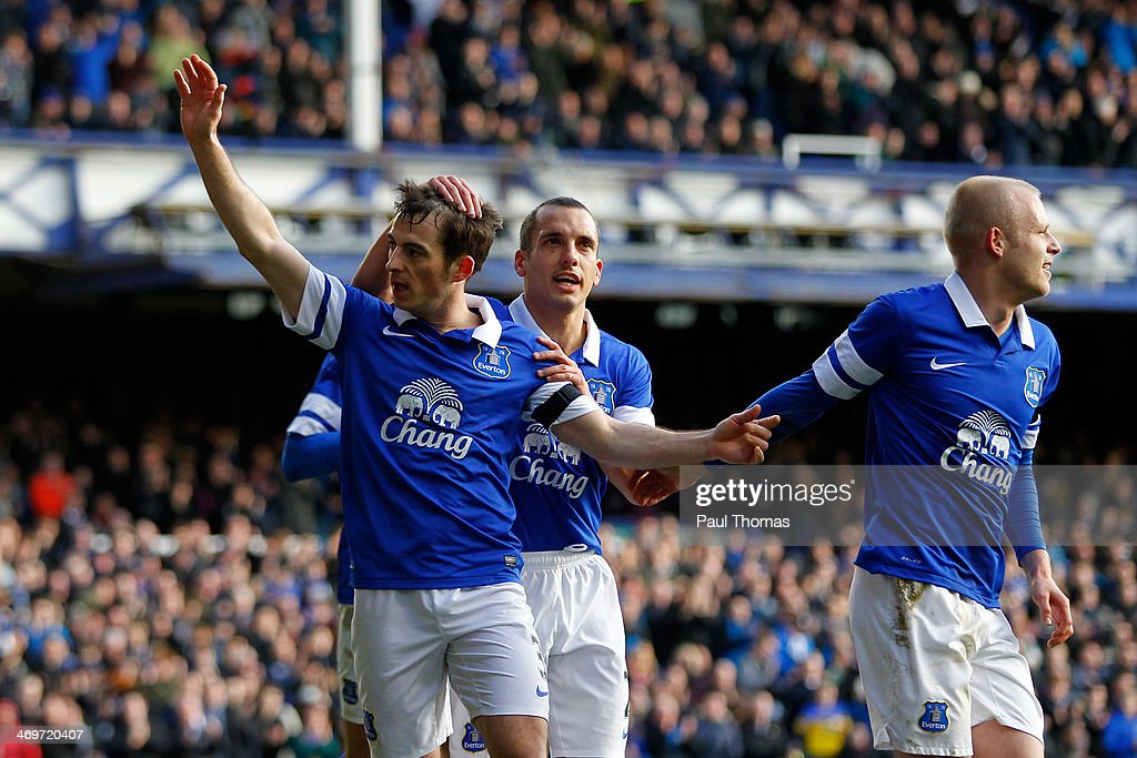 <a gi-track='captionPersonalityLinkClicked' href=/galleries/search?phrase=Leighton+Baines&family=editorial&specificpeople=682452 ng-click='$event.stopPropagation()'>Leighton Baines</a> (L) of Everton celebrates his goal with team mates <a gi-track='captionPersonalityLinkClicked' href=/galleries/search?phrase=Steven+Naismith&family=editorial&specificpeople=4130861 ng-click='$event.stopPropagation()'>Steven Naismith</a> (R) and <a gi-track='captionPersonalityLinkClicked' href=/galleries/search?phrase=Leon+Osman&family=editorial&specificpeople=208939 ng-click='$event.stopPropagation()'>Leon Osman</a> during the FA Cup Fifth Round match between Everton and Swansea City at Goodison Park on February 16, 2014 in Liverpool, England.
