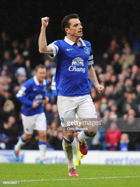Leighton Baines of Everton celebrates scoring from the penalty spot during the Barclays Premier League match between Everton and Swansea City at...