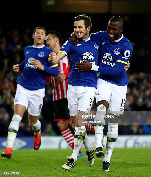 Leighton Baines of Everton celebrates scoring his team's second goal with Enner Valencia during the Premier League match between Everton and...