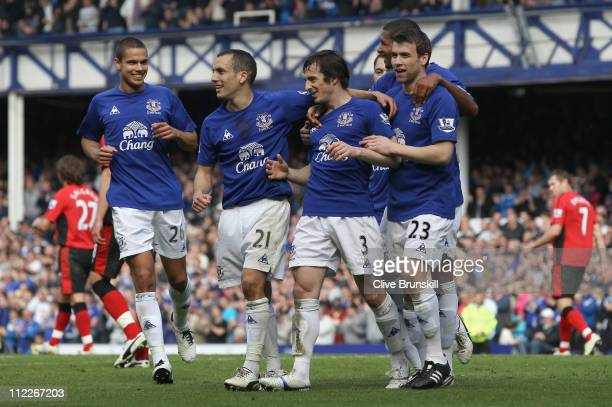 Leighton Baines of Everton celebrates with team mates after scoring the second goal from the penalty spot during the Barclays Premier League match...