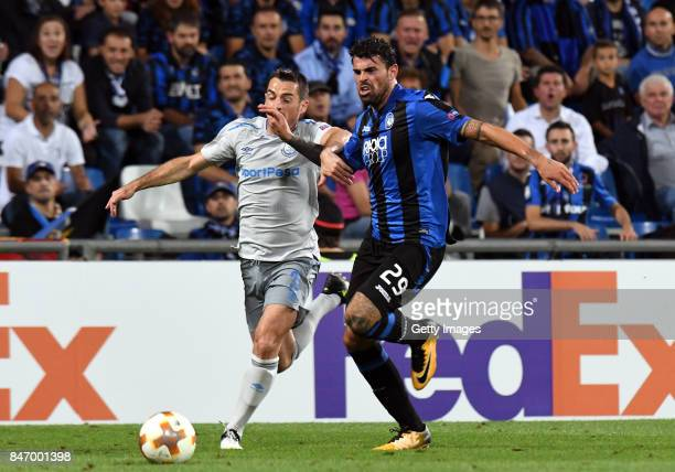 Leighton Baines of Everton competes for the ball with Andrea Petagna of Atalanta during the UEFA Europa League group E match between Atalanta and...