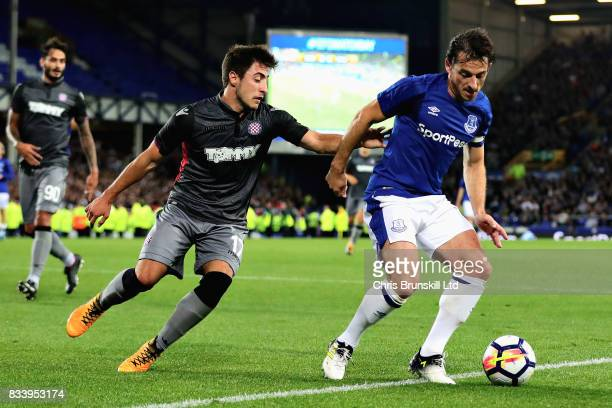 Leighton Baines of Everton dribbles away from Josip Juranovic of Hajduk Split during the UEFA Europa League Qualifying PlayOffs round first leg match...