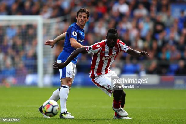 Leighton Baines of Everton in action with Mame Biram Diouf of Stoke City during the Premier League match between Everton and Stoke City at Goodison...