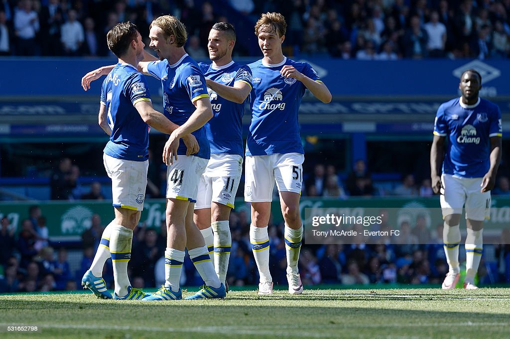 Leighton Baines (L) of Everton is congratulated for scoring his penalty during the Barclays Premier League match between Everton and Norwich City at Goodison Park on May 15, 2016 in Liverpool, England.