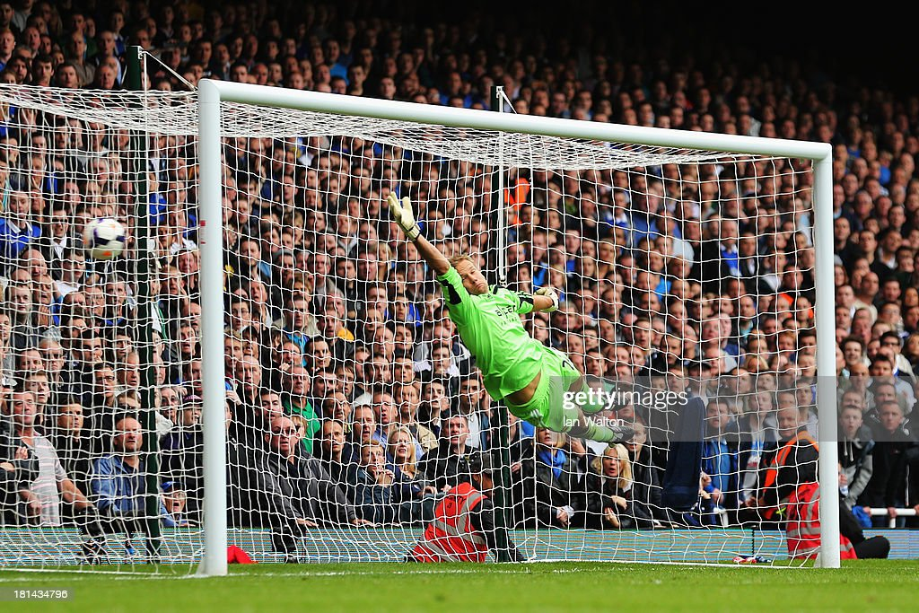 Leighton Baines (unseen) of Everton scores from a freekick past <a gi-track='captionPersonalityLinkClicked' href=/galleries/search?phrase=Jussi+Jaaskelainen&family=editorial&specificpeople=240728 ng-click='$event.stopPropagation()'>Jussi Jaaskelainen</a> the West Ham United goalkeeper during the Barclays Premier League match between West Ham United and Everton at the Boleyn Ground on September 21, 2013 in London, England.