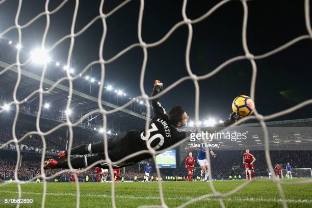 Leighton Baines of Everton scores his sides third goal past Costel Pantilimon of Wartford during the Premier League match between Everton and Watford...