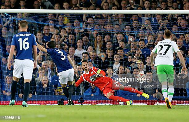 Leighton Baines of Everton scores his team's third goal from the penalty spot past goalkeeper Diego Benaglio of VfL Wolfsburg during the UEFA Europa...