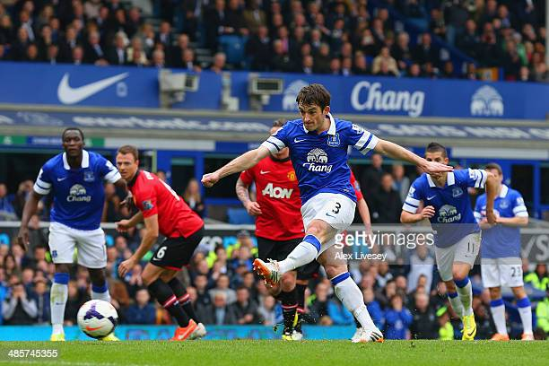 Leighton Baines of Everton scores the opening goal from the penalty spot during the Barclays Premier League match between Everton and Manchester...