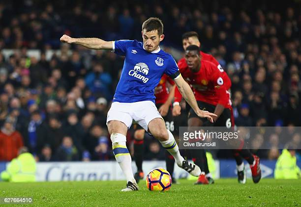 Leighton Baines of Everton scores their first and equalising goal from the penalty spot during the Premier League match between Everton and...