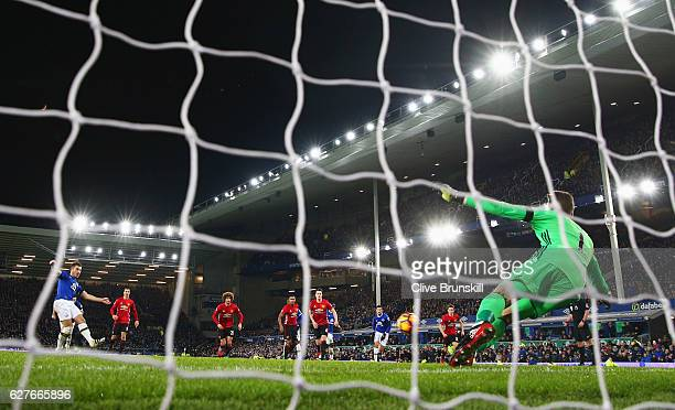Leighton Baines of Everton scores their first and equalising goal from the penalty spot past goalkeeper David De Gea of Manchester United during the...
