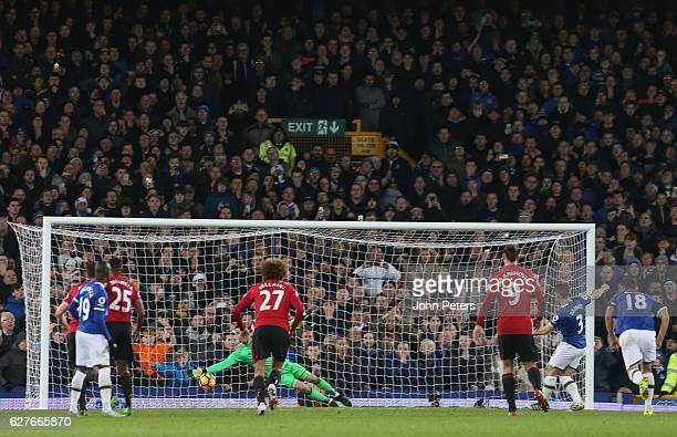 Leighton Baines of Everton scores their first goal during the Premier League match between Everton and Manchester United at Goodison Park on December...