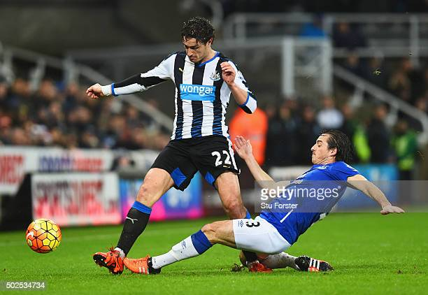 Leighton Baines of Everton slides to tackle Daryl Janmaat of Newcastle United during the Barclays Premier League match between Newcastle United and...
