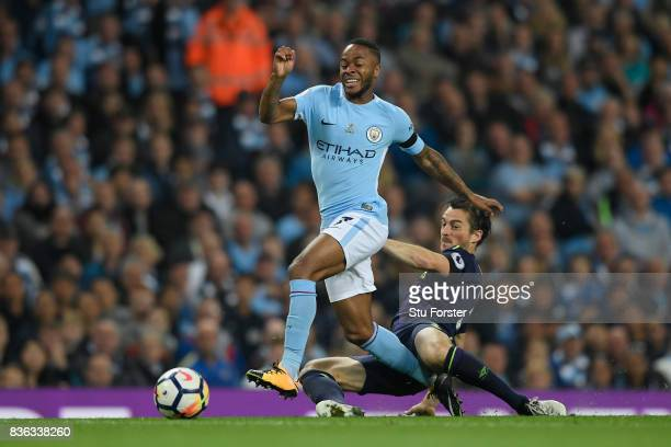 Leighton Baines of Everton tackles Raheem Sterling of Manchester City during the Premier League match between Manchester City and Everton at Etihad...