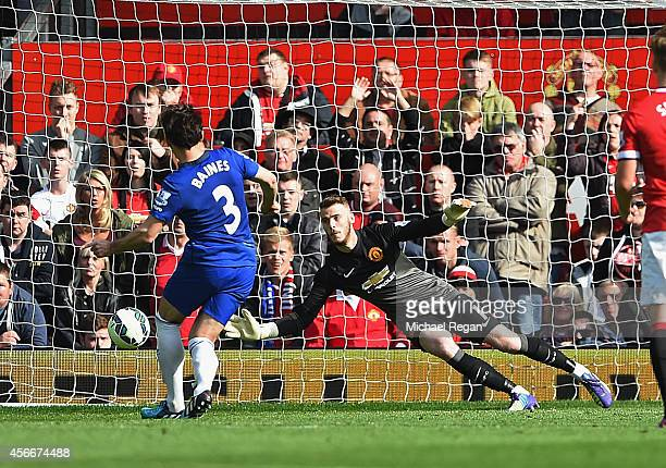 Leighton Baines of Everton takes and has a penalty kick saved by David De Gea of Manchester United during the Barclays Premier League match between...