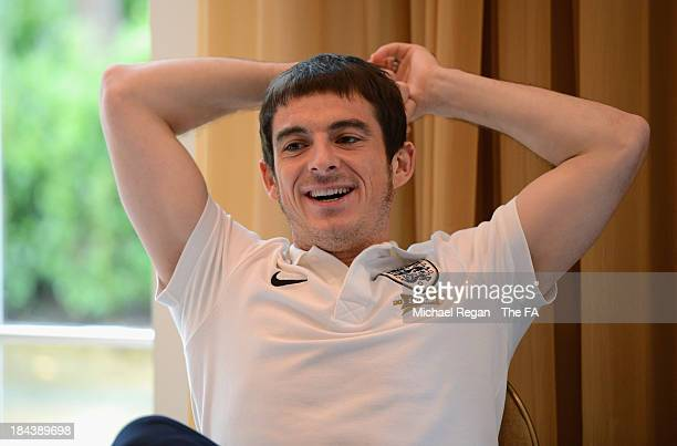 Leighton Baines speaks to the media during the England press conference at The Grove Hotel on October 13 2013 in Hertford England